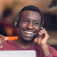 man-with-headset-smiling@2x